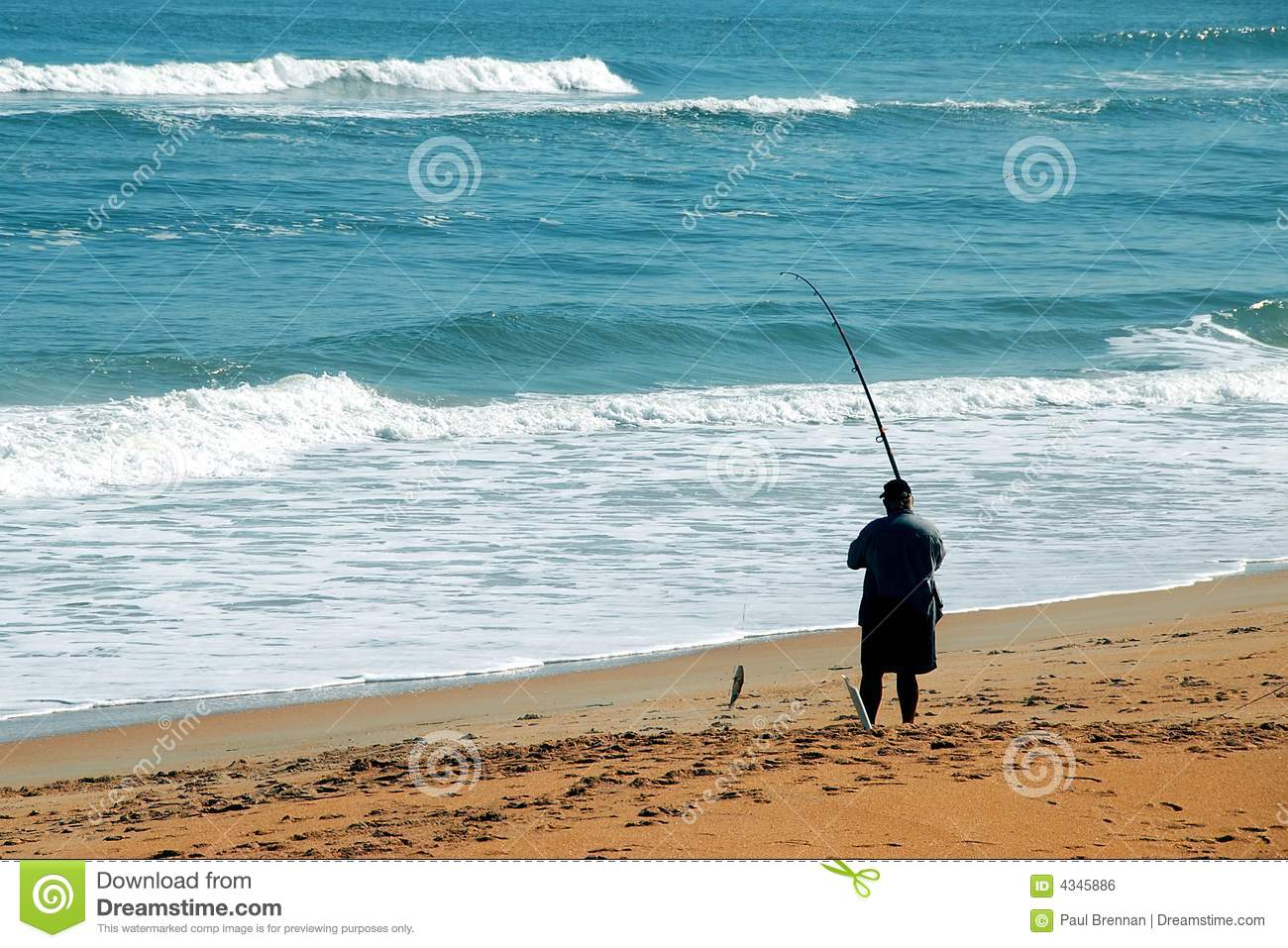 Man angling in surf from beach