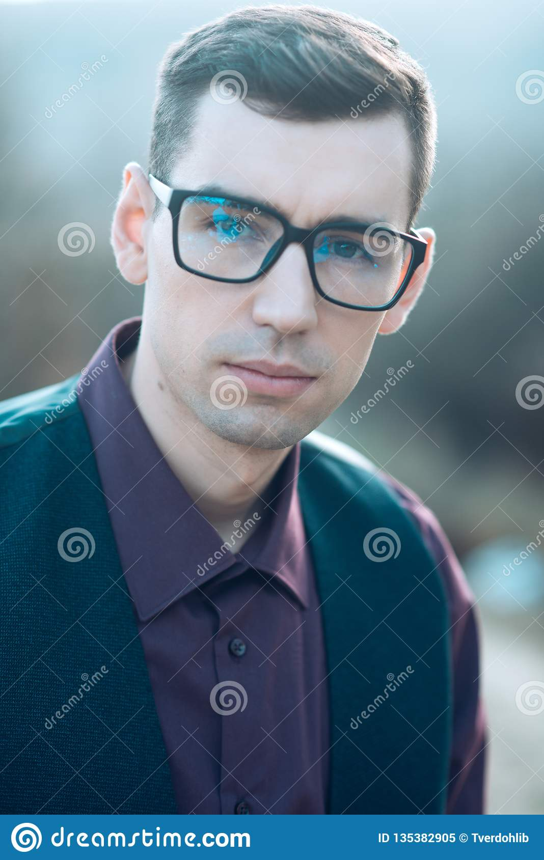 Man in anti-reflection glasses for visual improvement at oculist. poor eyesight and eye healthcare. Businessman grooming