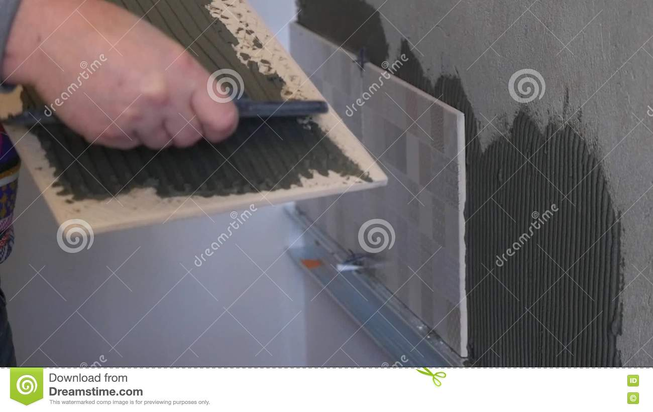 Gluing to ceramic tile image collections tile flooring design ideas gluing to ceramic tile image collections tile flooring design ideas man applying glue to ceramic tile dailygadgetfo Images