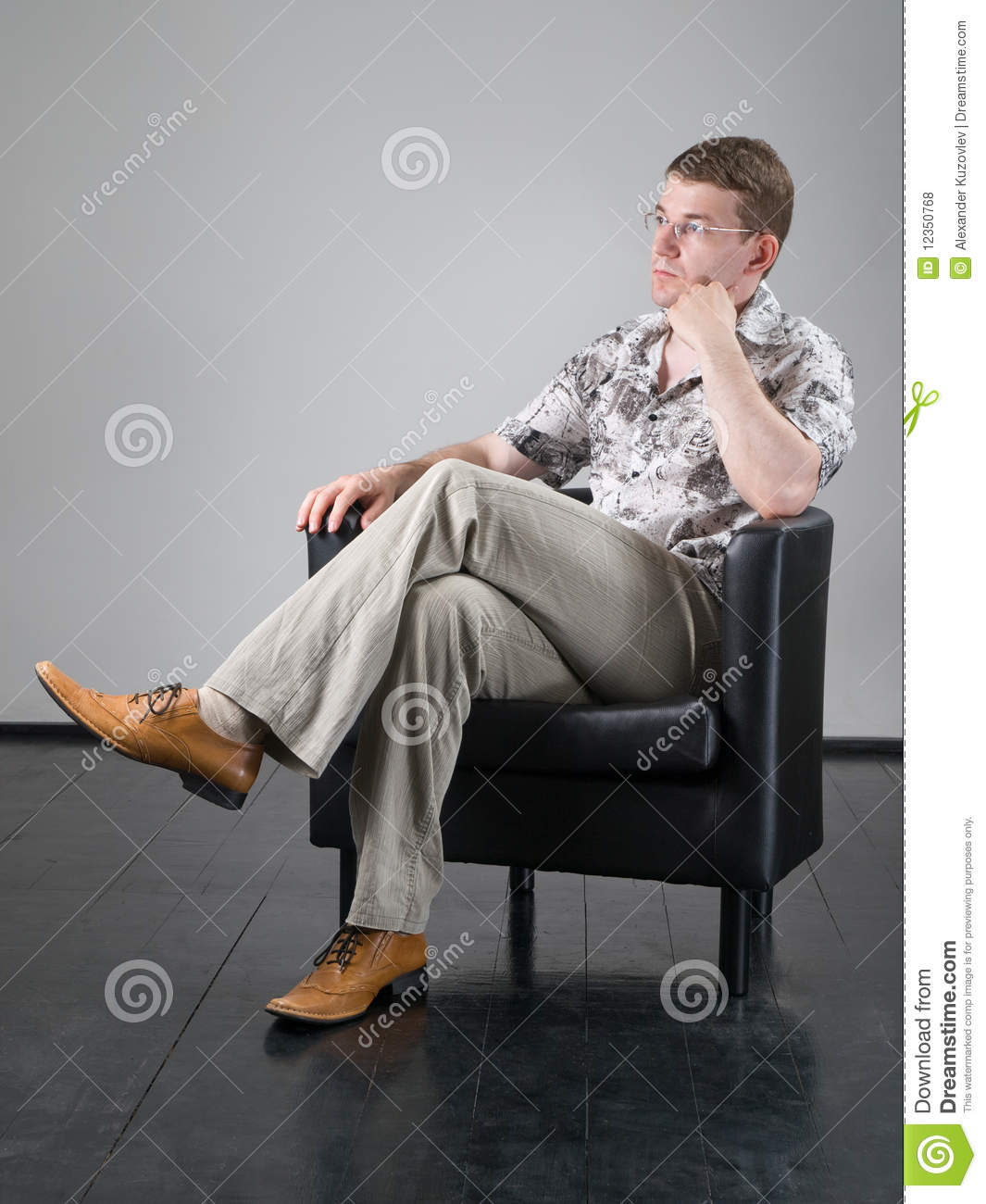 Man in armchair royalty free stock photos image 12350768 for Sitting in armchair