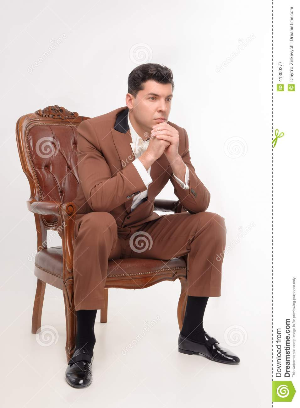 Man in armchair stock photo image 41300277 for Sitting in armchair