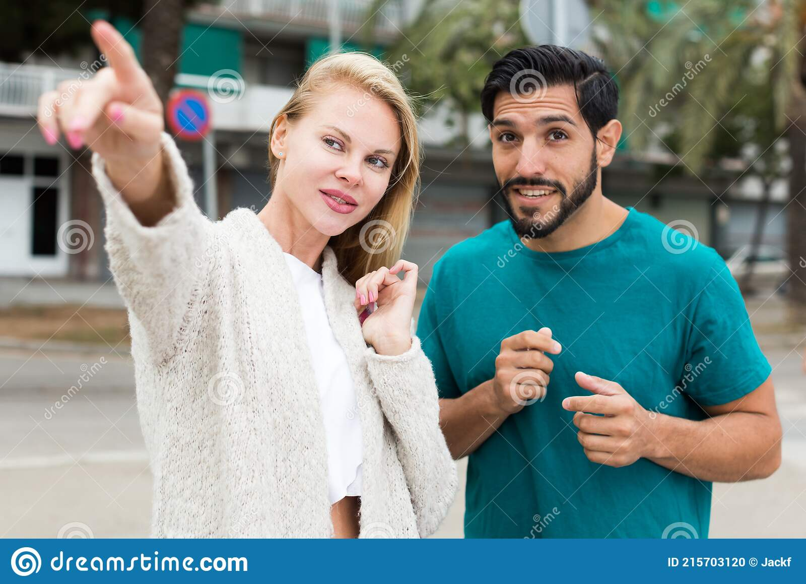 Man Asking Woman To Stop Talking On Phone, Looking Tired