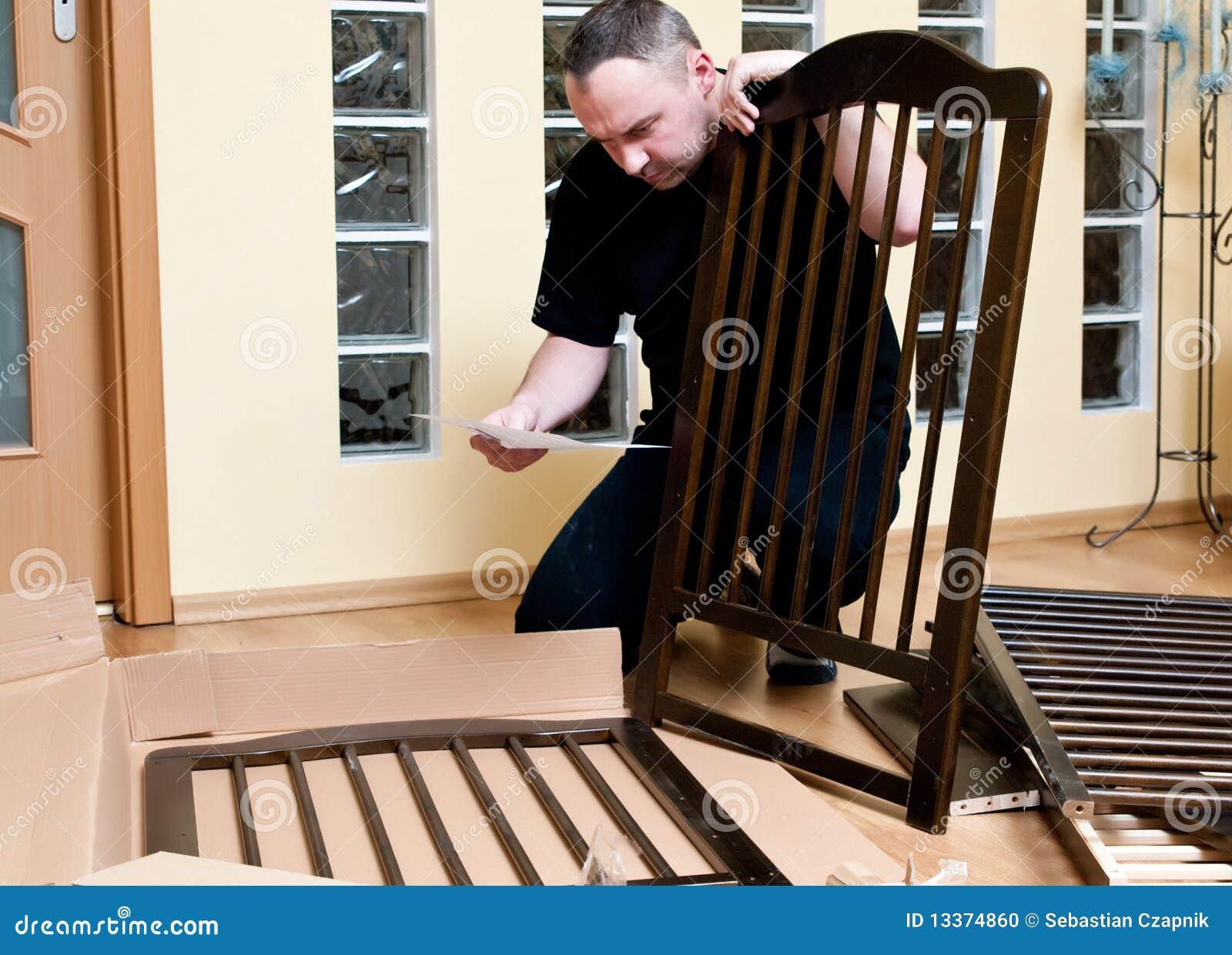 Man assembles a baby crib