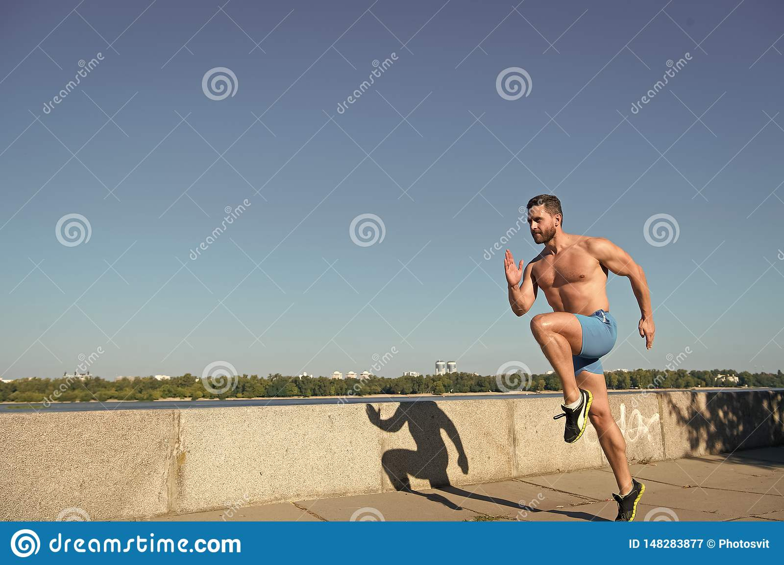 Man athlete muscular torso training outdoor. Morning run fills with energy. Runner training morning during sunrise