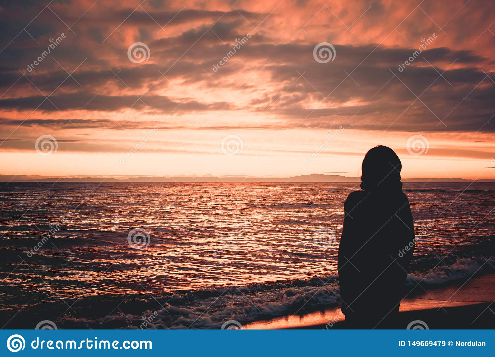 The man on the background of sunset at lake Baikal