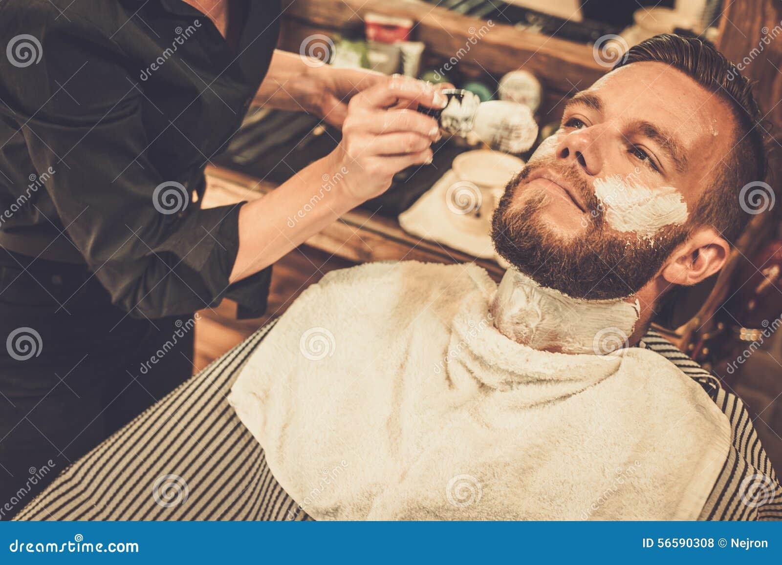 man in a barber shop stock photo image 56590308. Black Bedroom Furniture Sets. Home Design Ideas