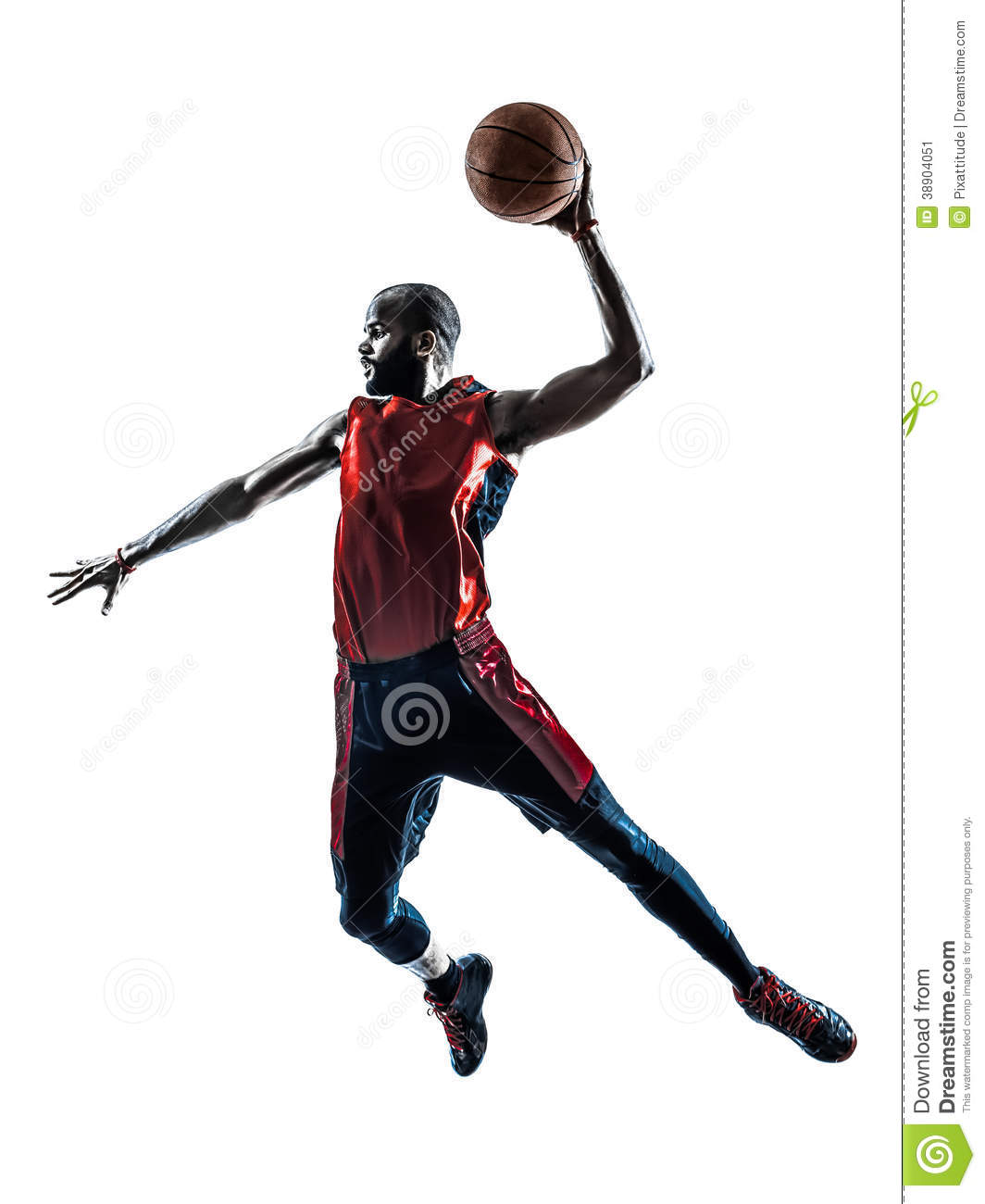 Man basketball player jumping dunking silhouette