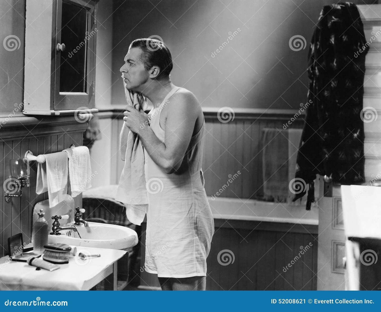 Man at bathroom mirror