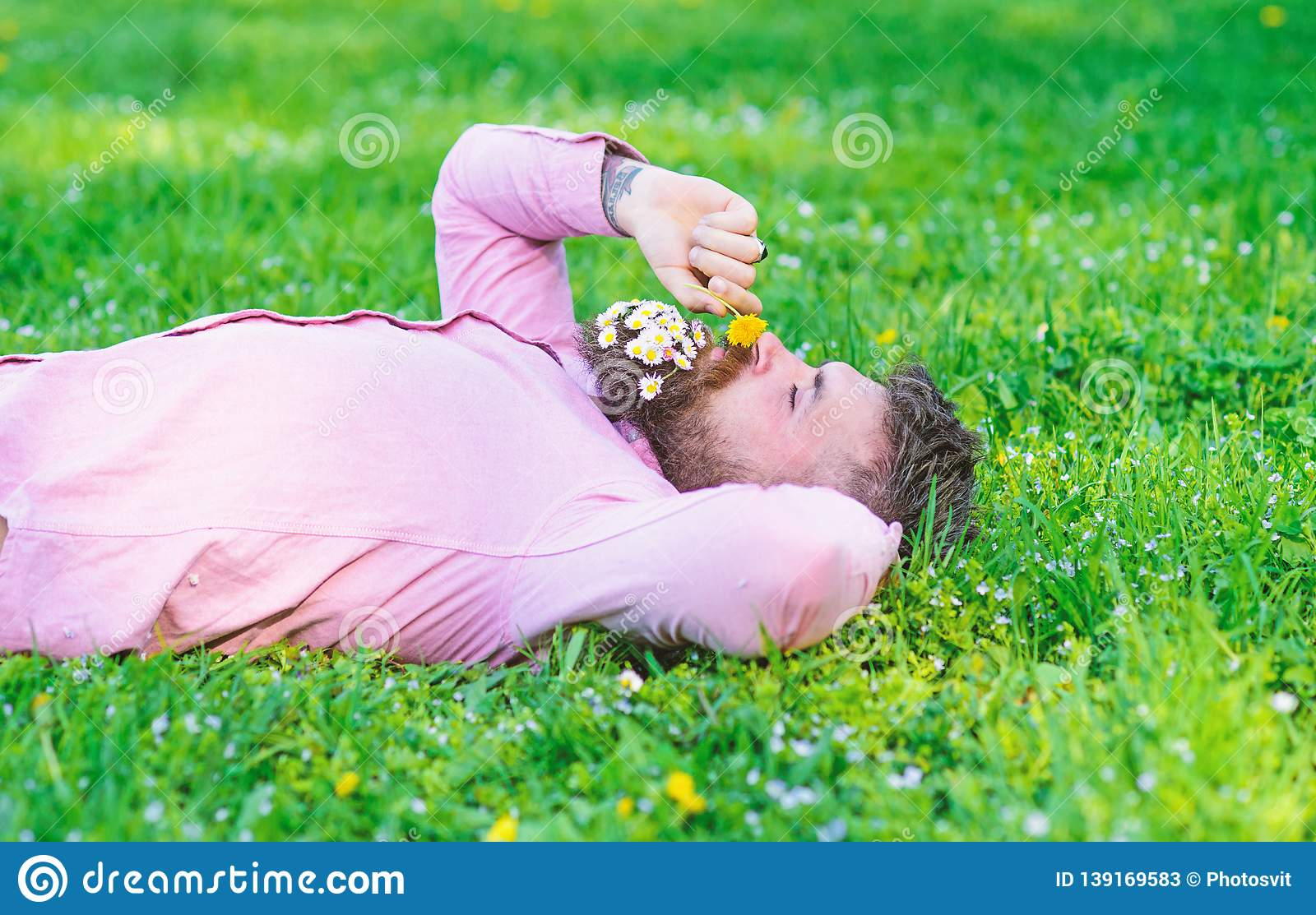 Man With Beard On Calm Face Sniffs Dandelion  Peace And Tranquility