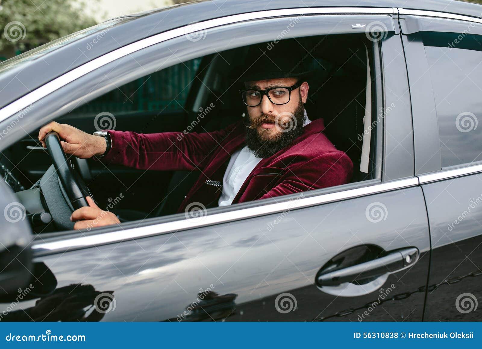 Man With Beard Driving A Car Stock Photo Image 56310838