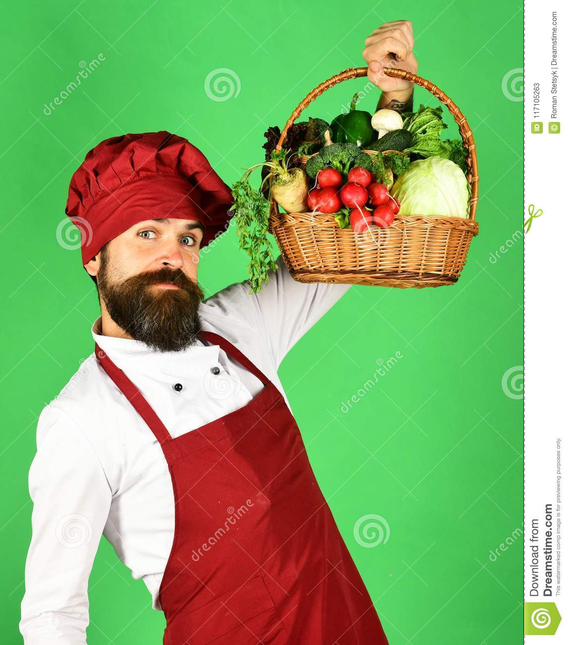 man with beard on green background chef holds ve stock image
