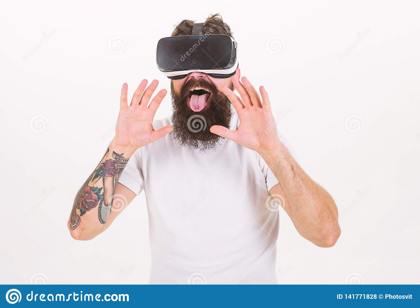 Man with beard in VR glasses, white background. Virtual sex concept. Guy with head mounted display having sex in virtual