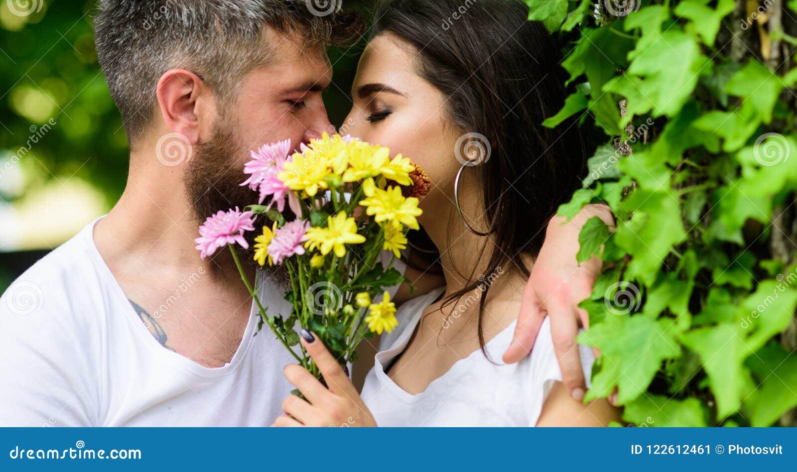 man bearded hipster kisses girlfriend secret romantic kiss love