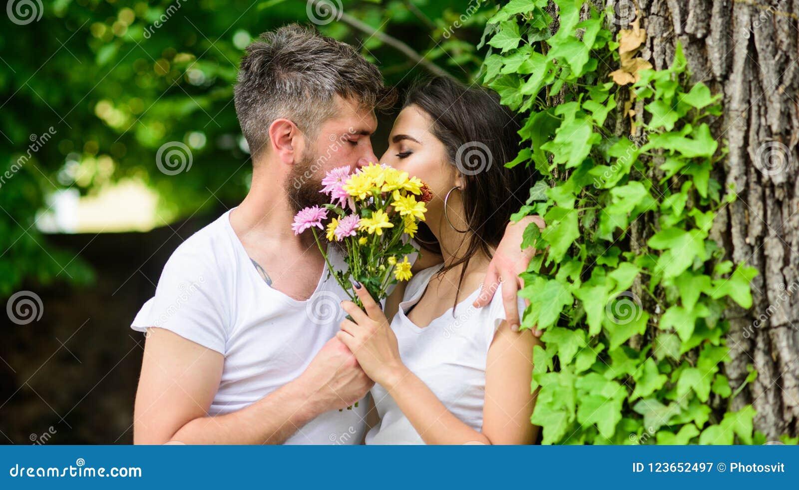man bearded hipster kisses girlfriend secret romantic kiss moment