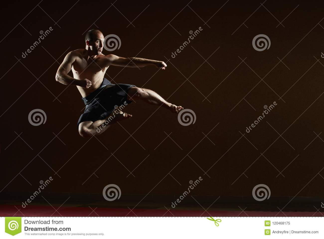 The man beats a kick in the jump to the side