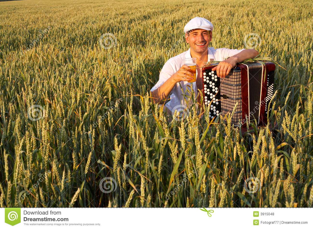 Man with beer in field