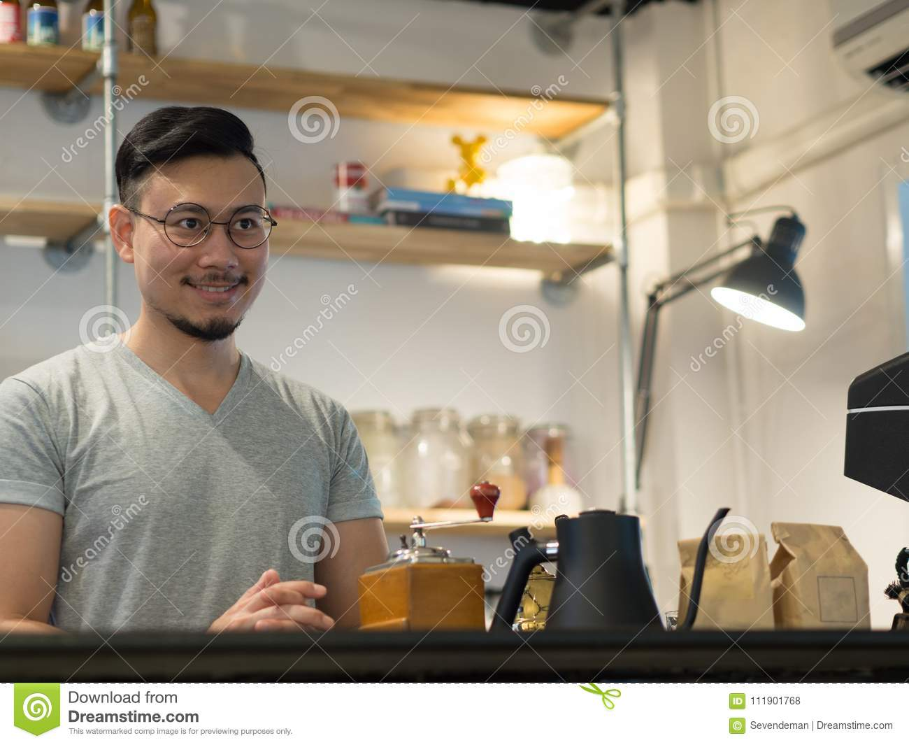 Man being barista and own a small coffee shop.