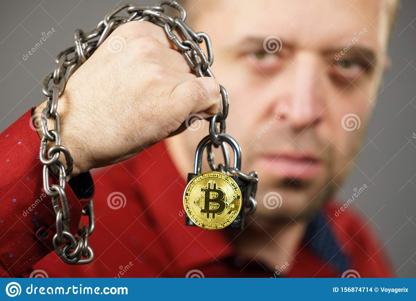 Man being tied up in block chain