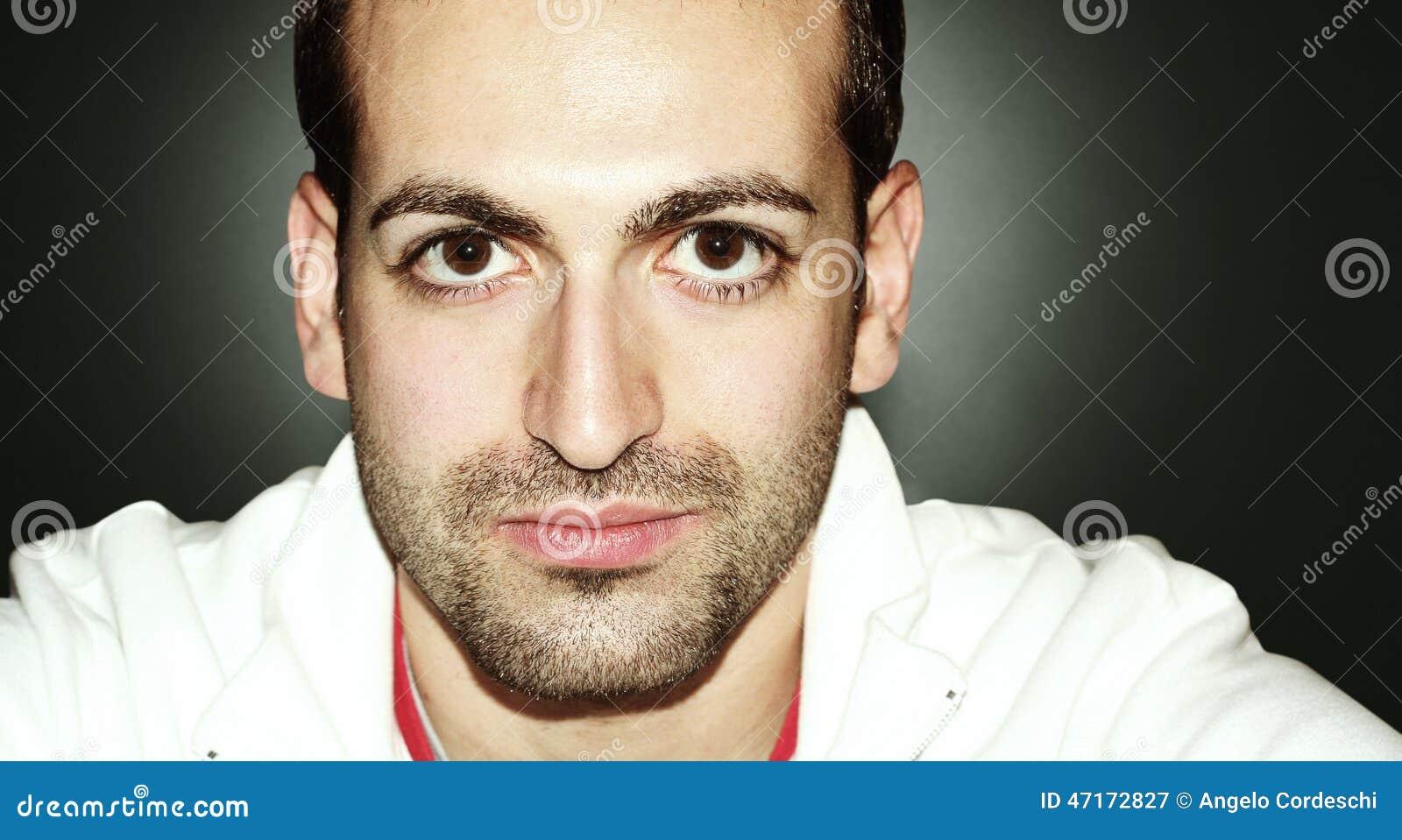 man with big eyes and beard horizontal portrait on grandient