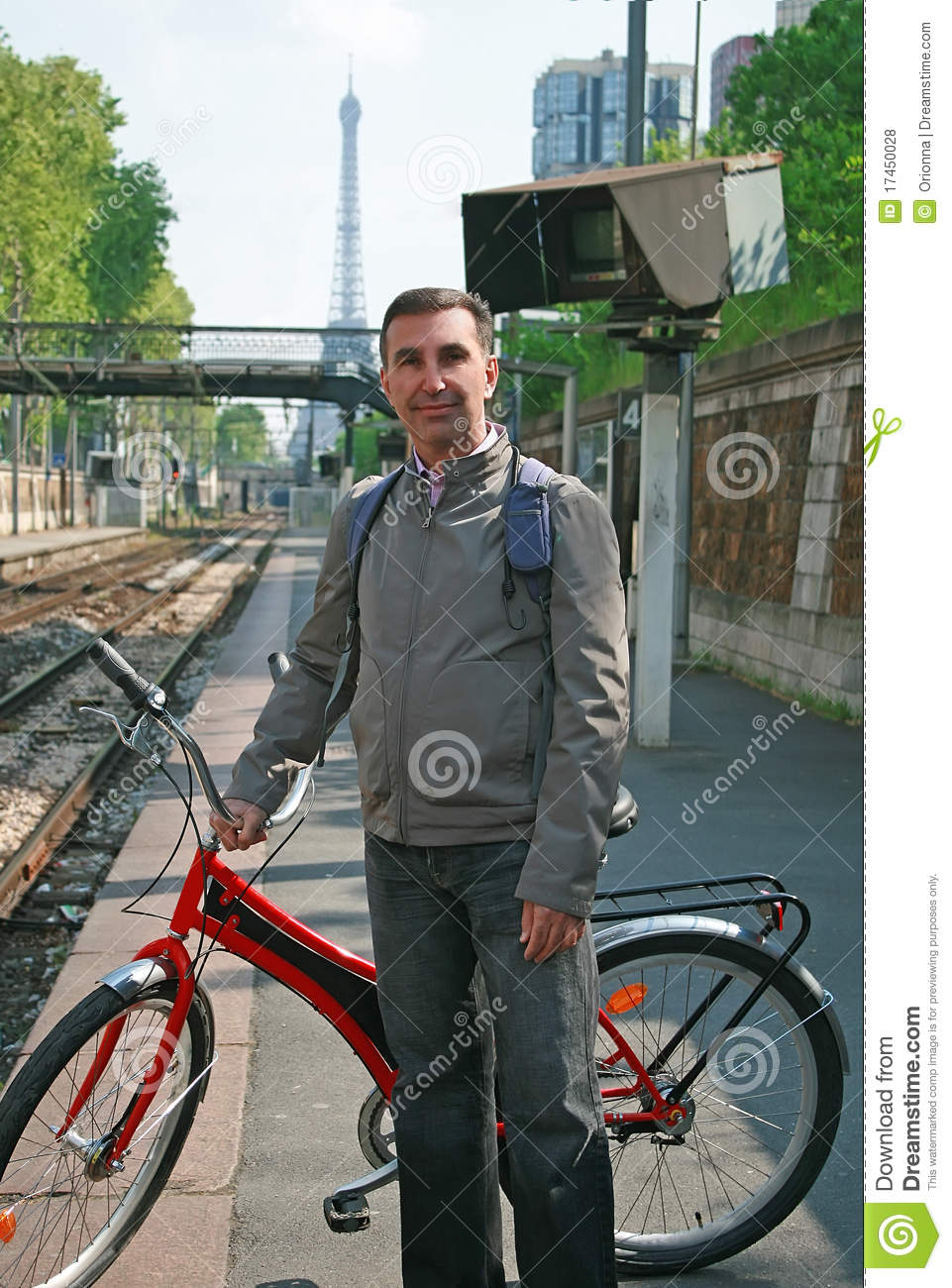 Man with bike in Paris