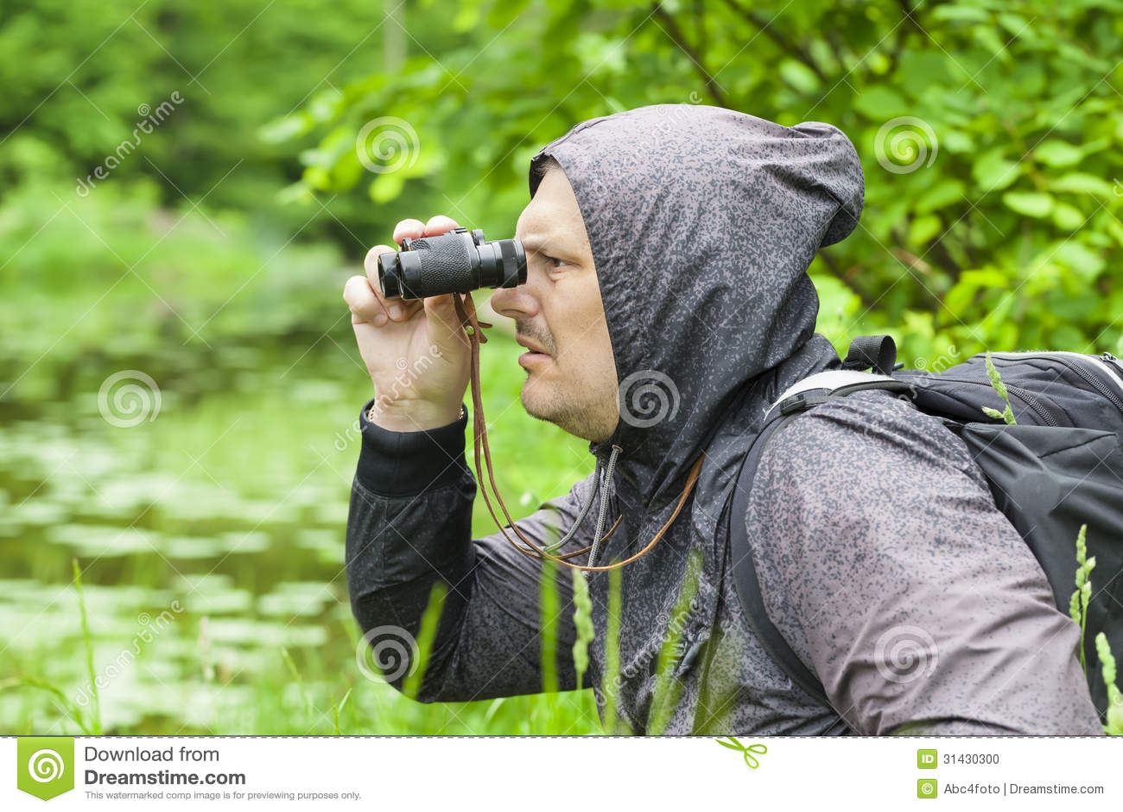Man With Binoculars Watching Birds Stock Photo