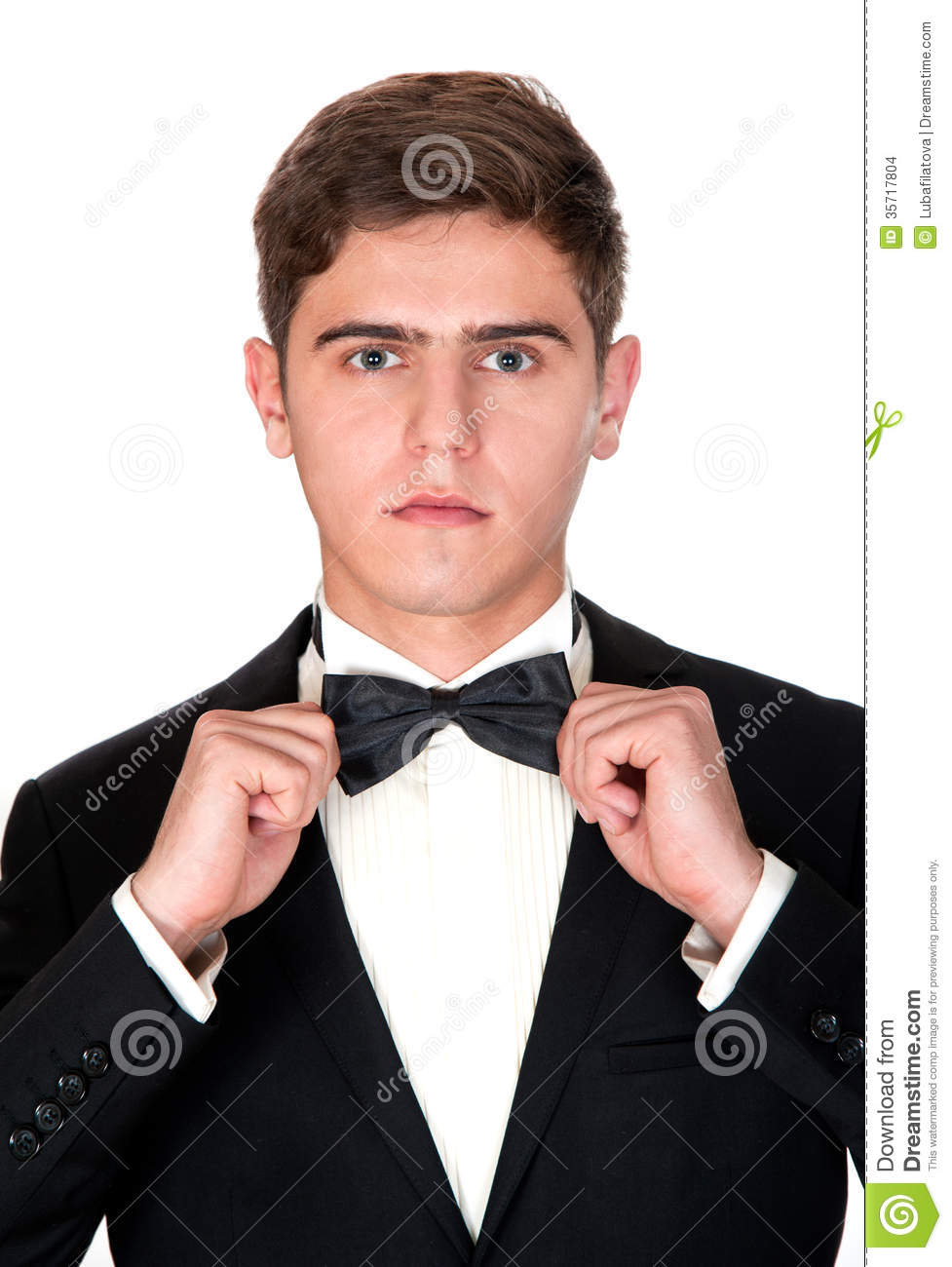 Man In A Black Suit Adjusts His Bow Tie Stock Images - Image: 35717804