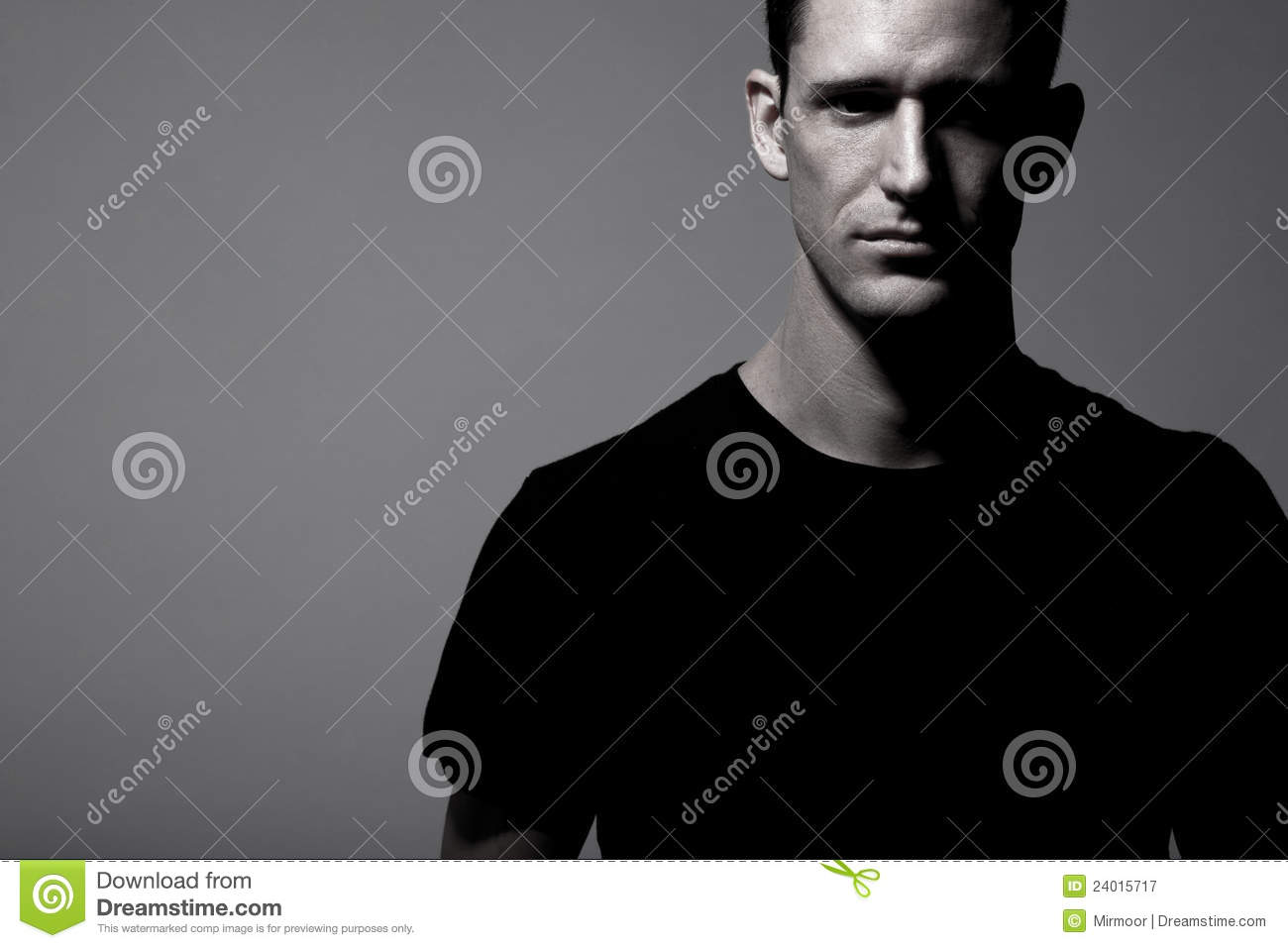 handsome man posing in black t shirt and bla royalty free stock photos
