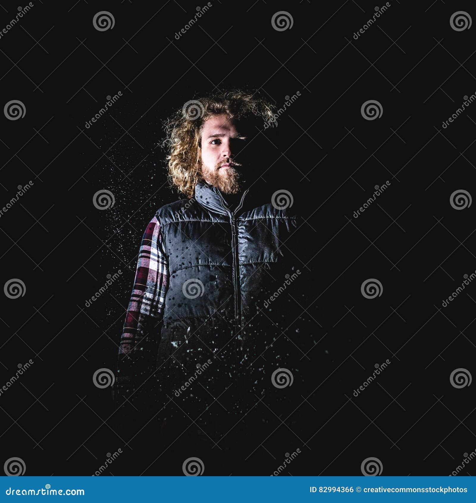 Man in Blond Hair Wearing Black Puffer Vest Standing