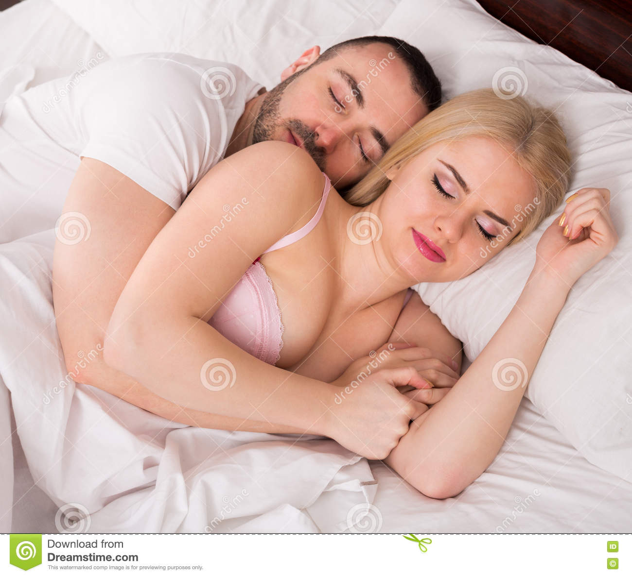 Man and blond woman sleeping