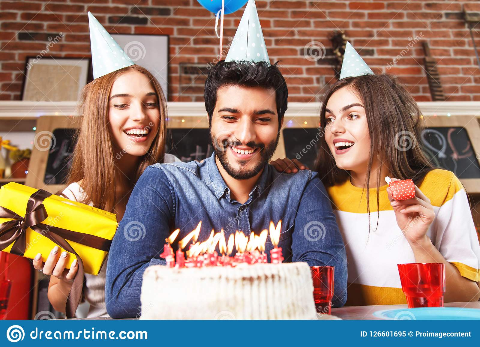 Man Blow Out Candles On White Cake