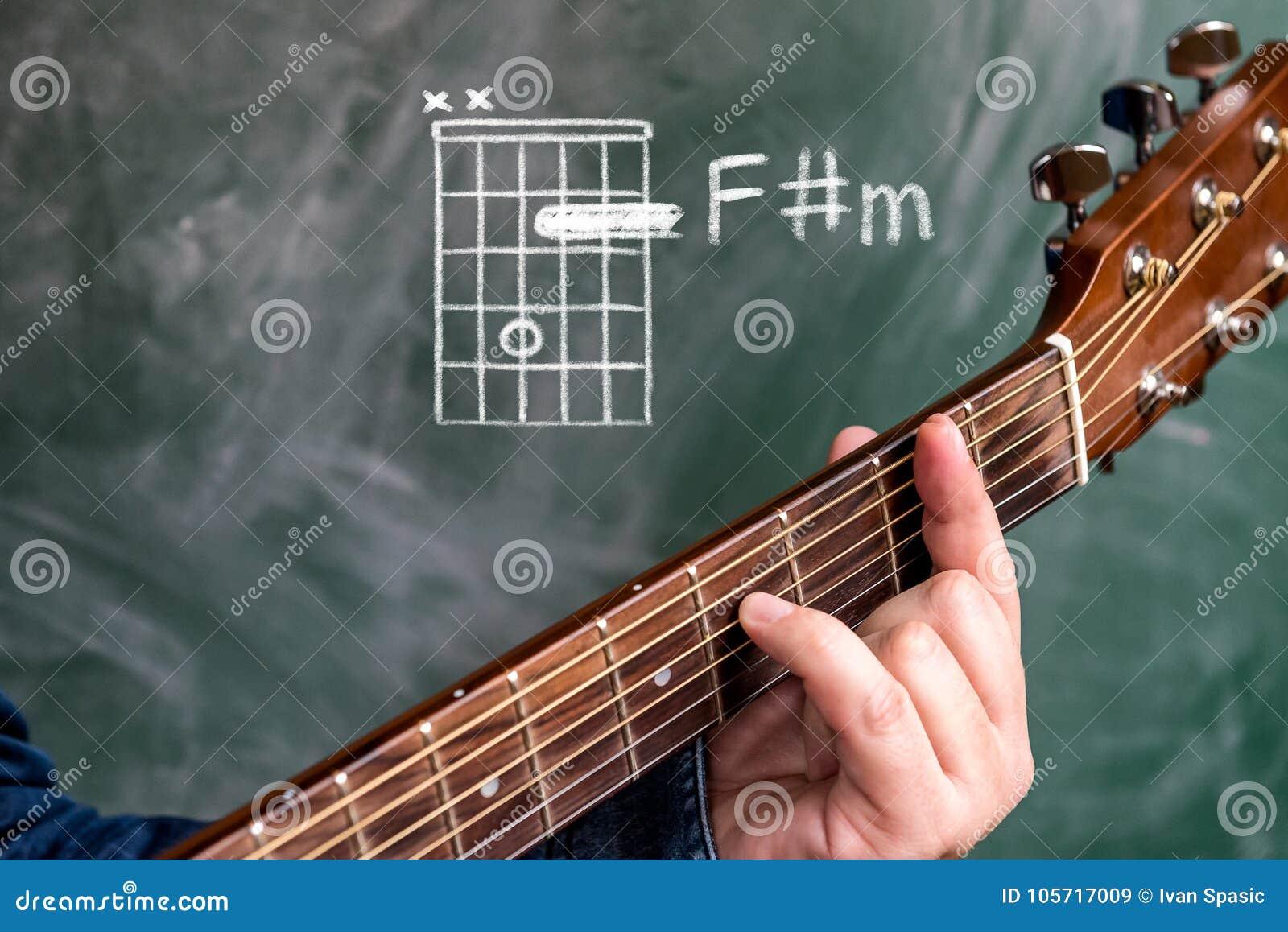 Man Playing Guitar Chords Displayed On A Blackboard Chord F Sharp