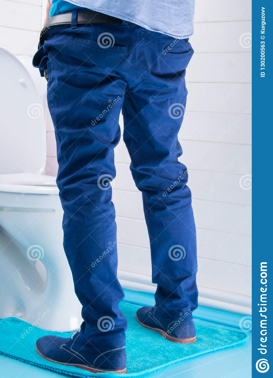 Man In Blue Pants Peeing In Toilet, Rear View Stock Image ...