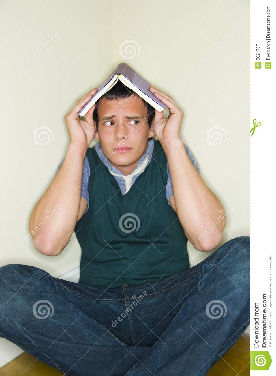 Man with book on his head