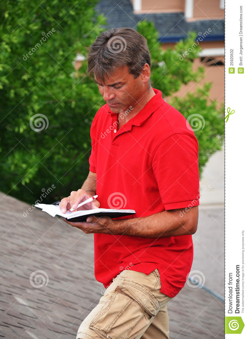 A Man With A Book On A Roof Stock Photo - Image of home
