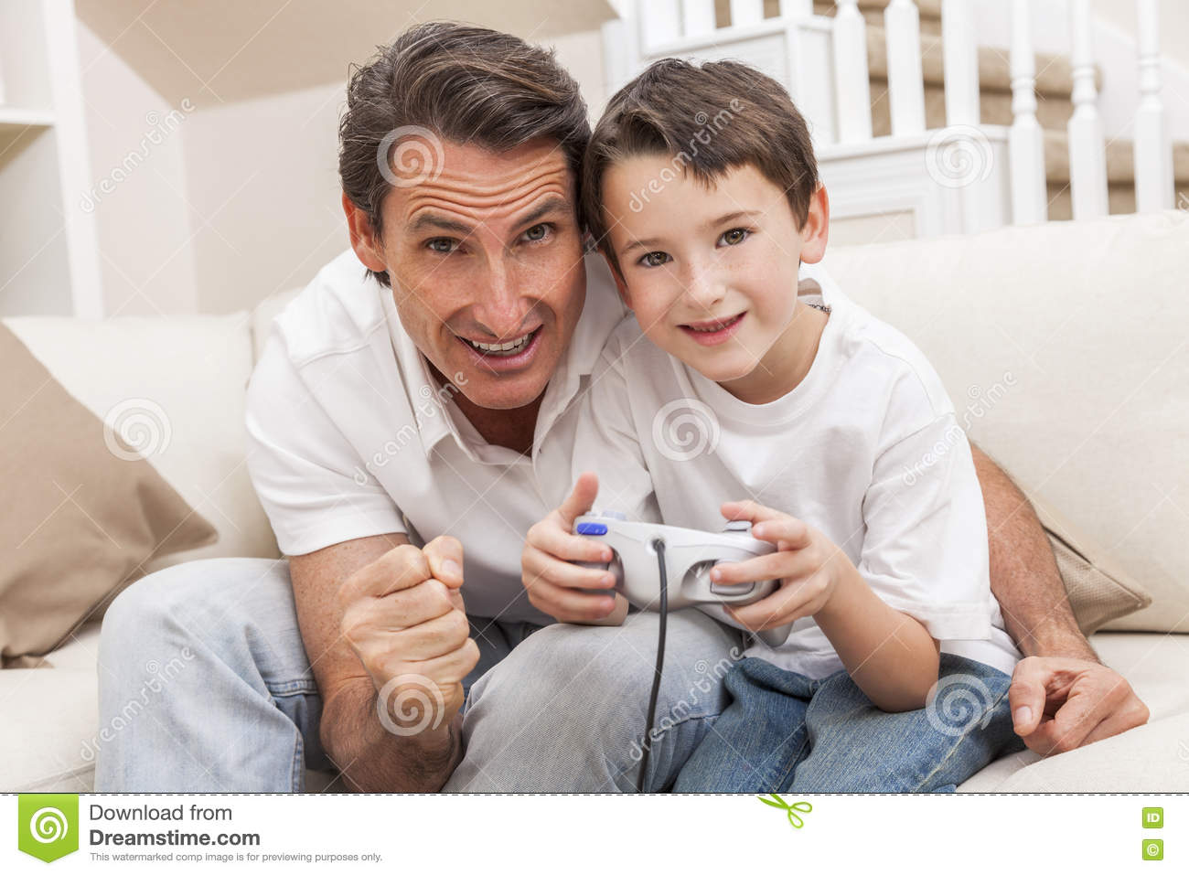 Download Man Boy Father Son Playing Computer Video Console Game Stock Photo - Image of game, jeans: 71496298
