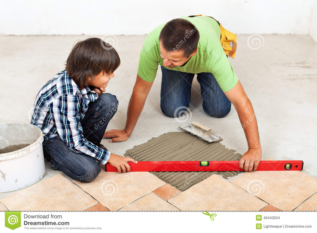 Working With Ceramic Tile : Laying ceramic floor tiles royalty free stock image
