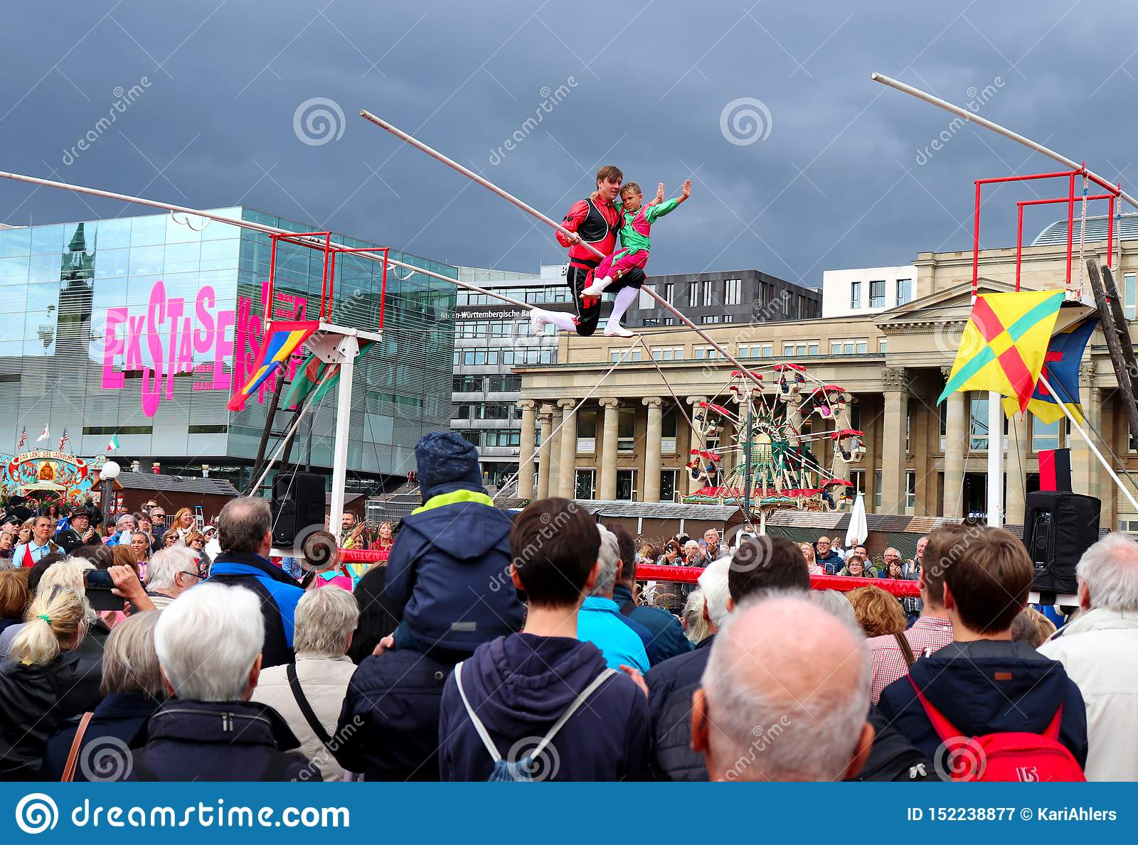 Man and boy pose on a tightrope in Germany