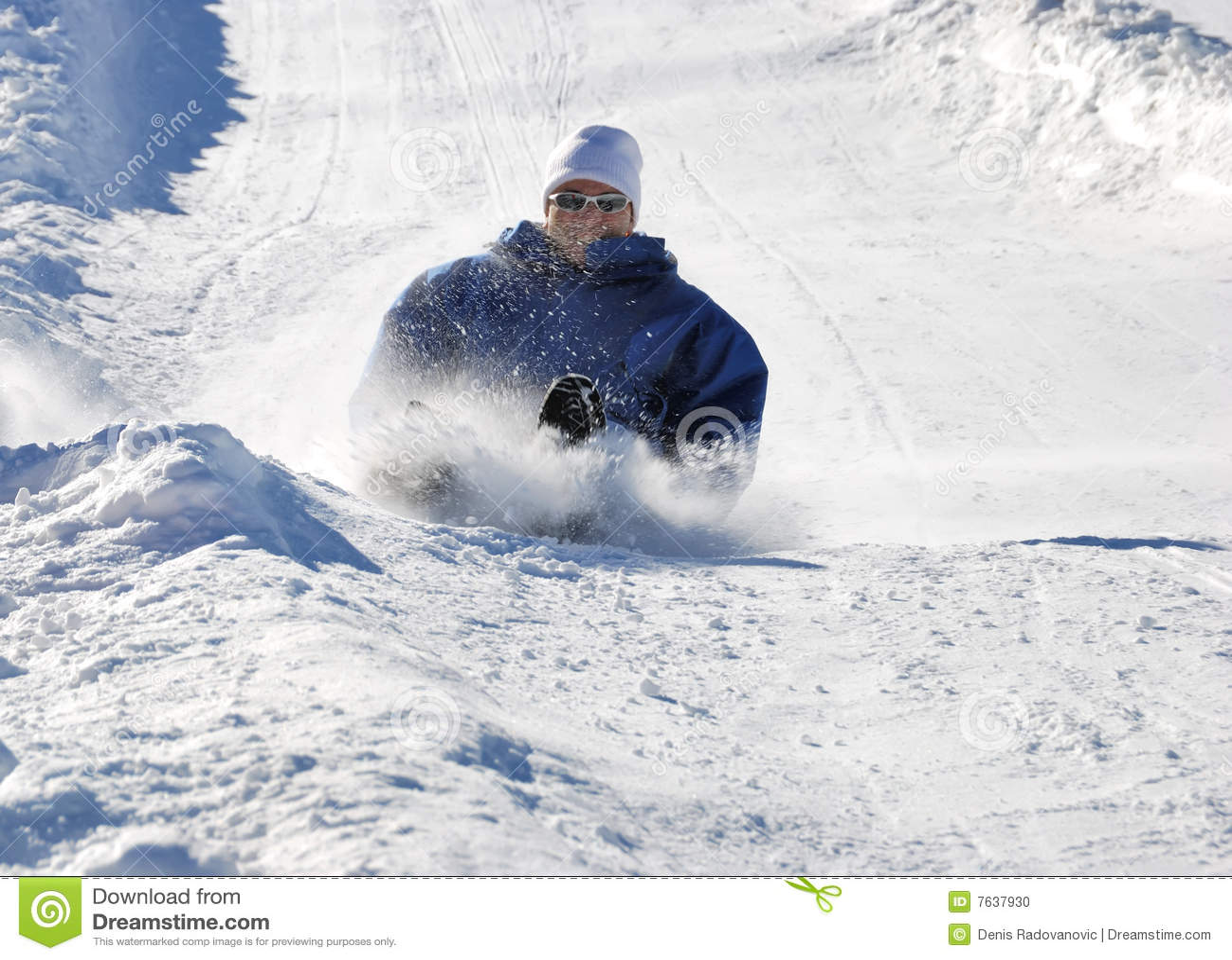 Man Braking While Sledding Down The Hill Stock Photo - Image: 7637930