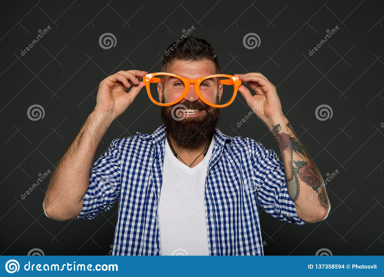 Man brutal bearded hipster wear funny eyeglasses accessory. Human strengths and virtues. Positive mood. Positive