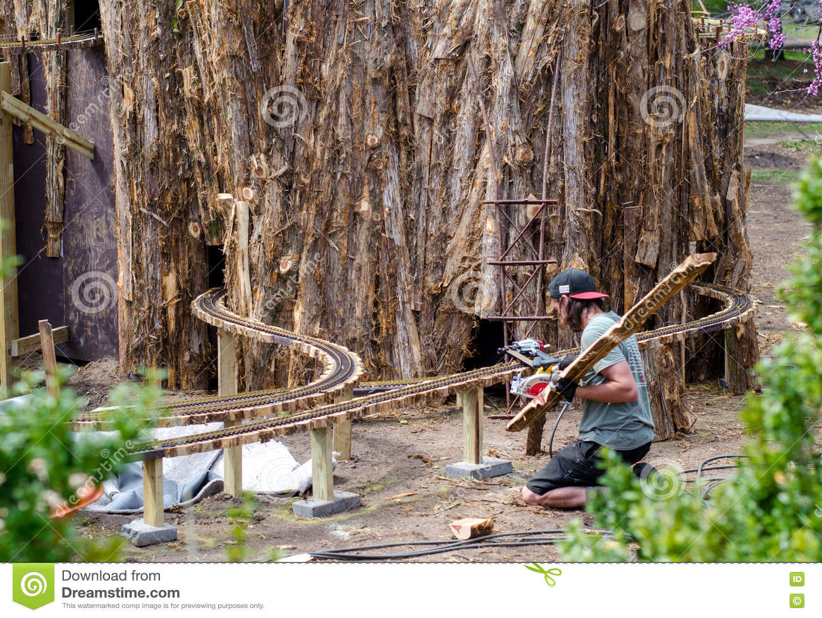 Man Building A Miniature Railroad Editorial Stock Photo