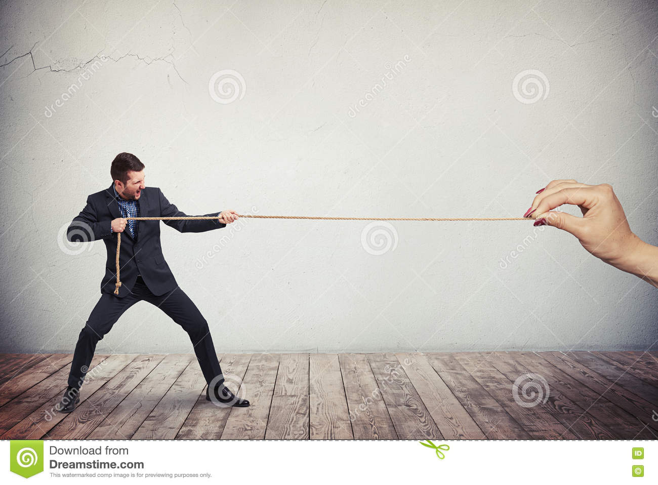 Man in business suit is pulling the rope