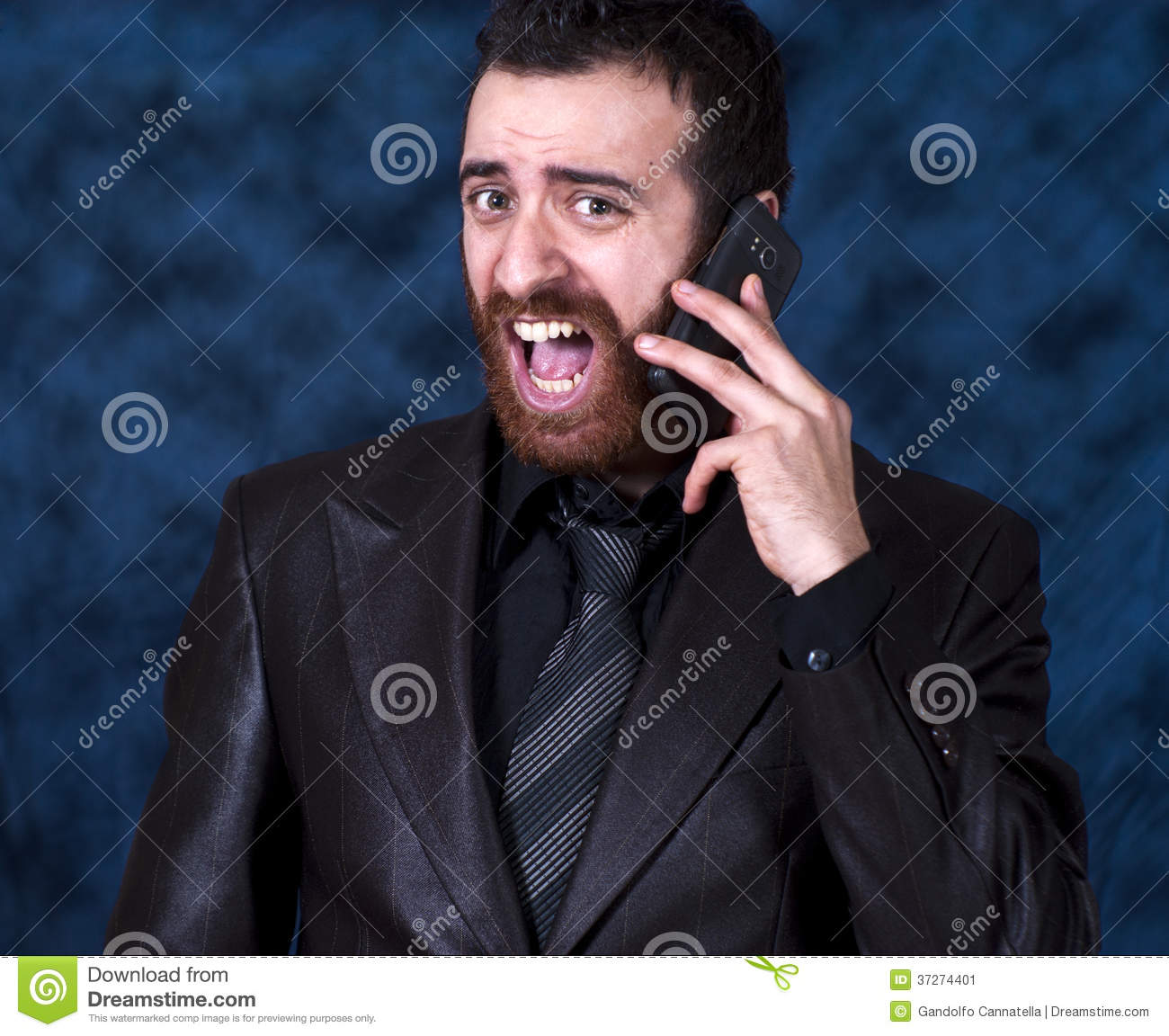 Man in business suit shouting into his mobile phone