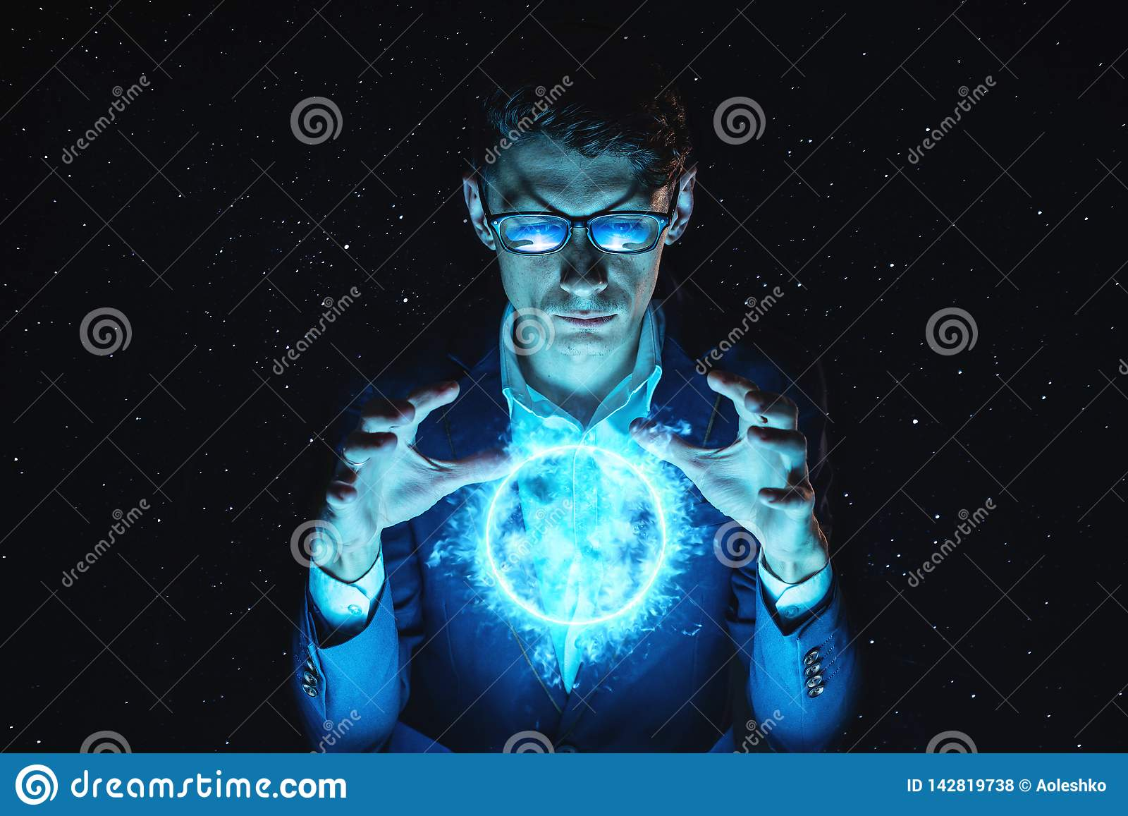 Man businessman holding hands over a blue glowing plasma sphere. Magic prediction and foresight in business and Finance