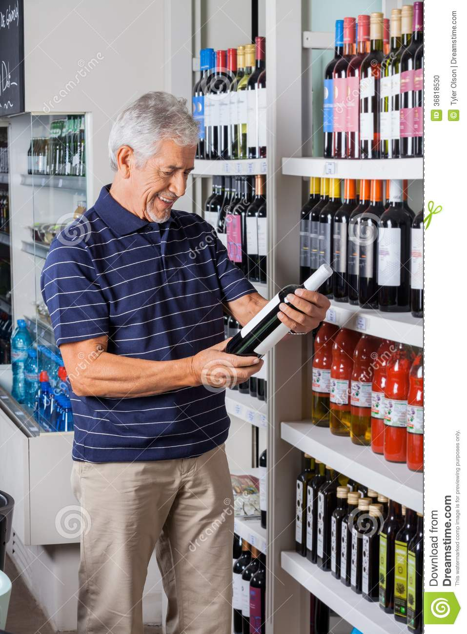 Buying A Full Face Snorkel Mask Reviews Of Full Face: Man Buying Alcohol At Supermarket Stock Photo