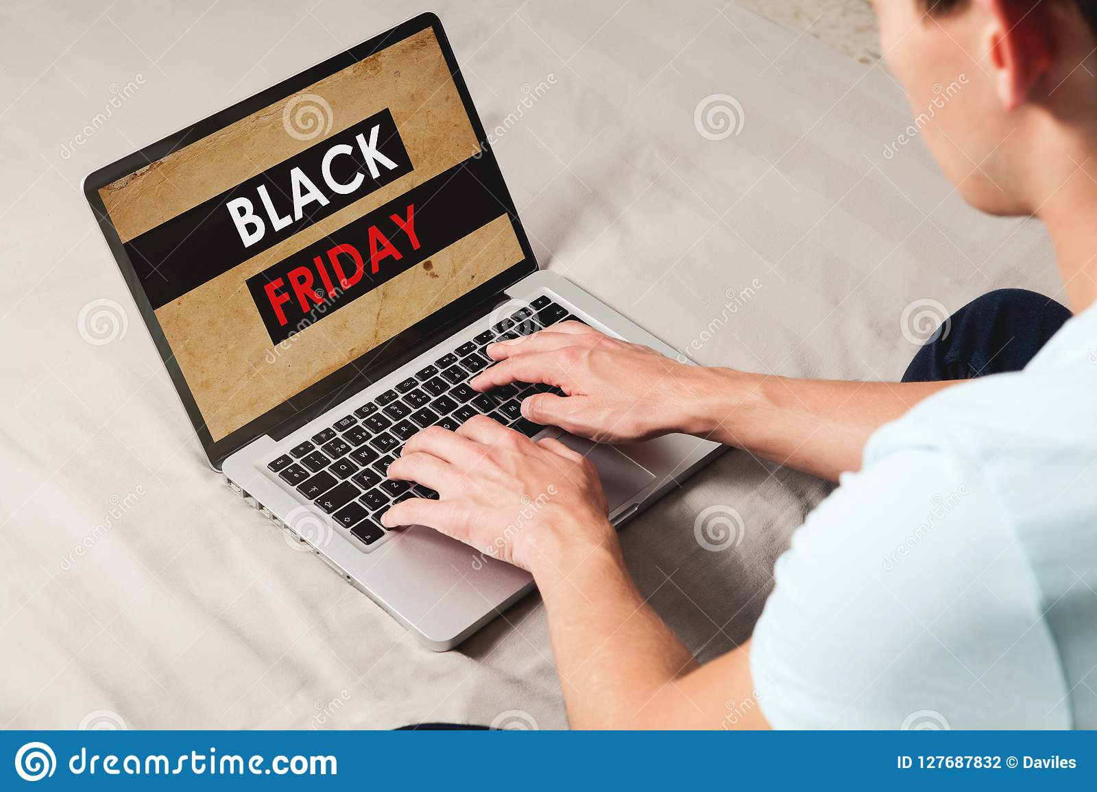 Man Shopping At Black Friday Special By The Internet With A Laptop While Sitting At Home Stock Photo Image Of Modern Offer 127687832