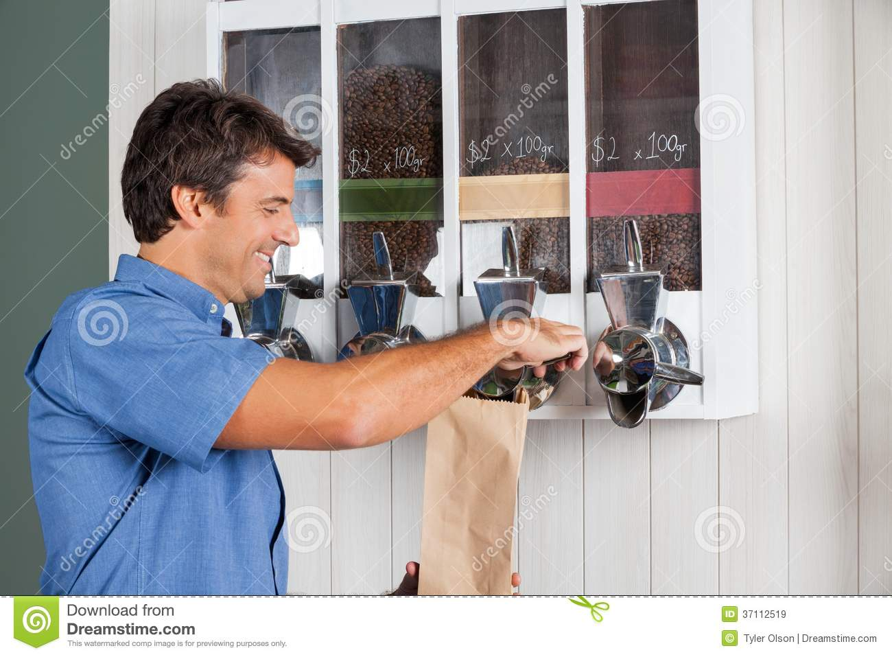 Man Buying Coffee From Vending Machine In Royalty Free ...
