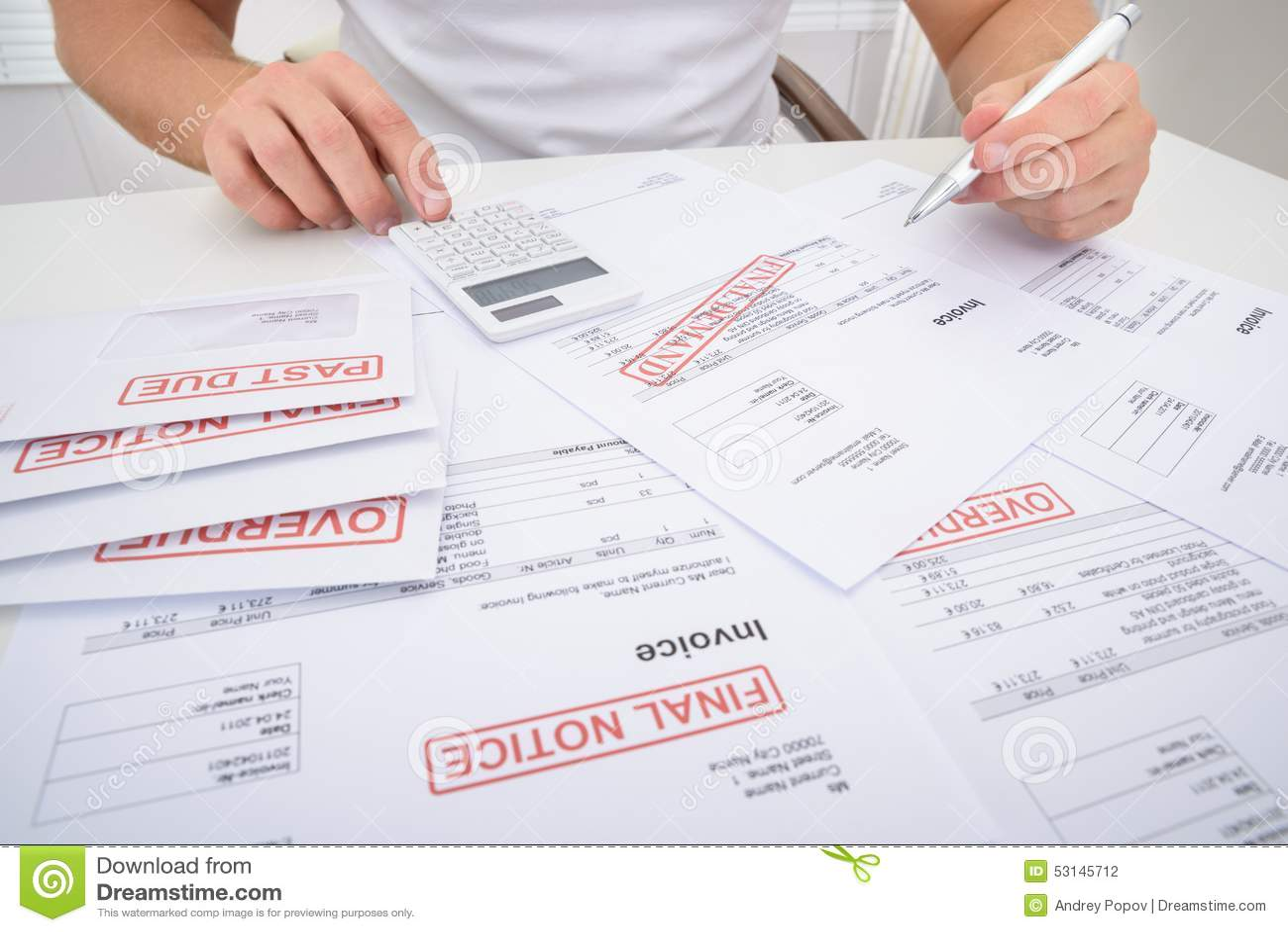 Man calculating unpaid bills