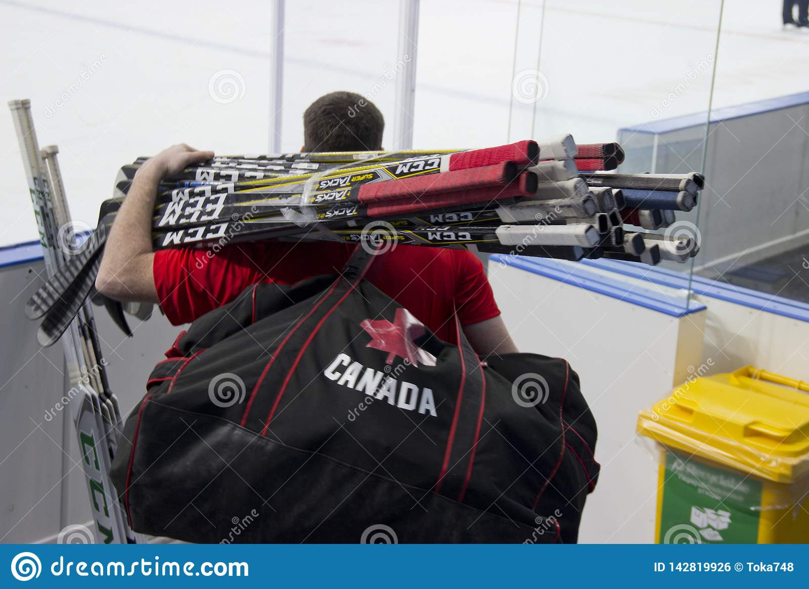 Man with hockey sticks