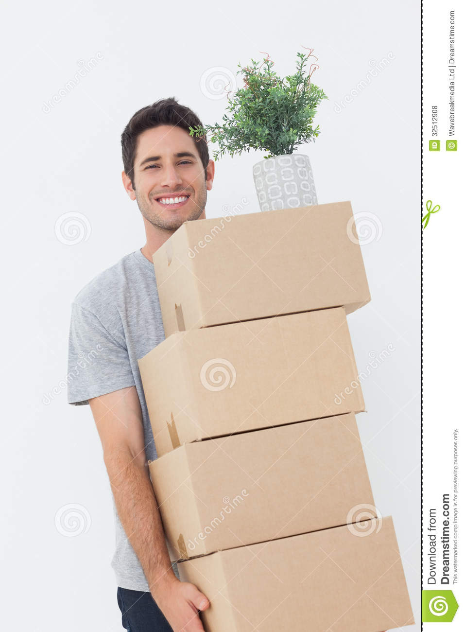 Man Carrying Boxes Because He Is Moving Royalty Free Stock