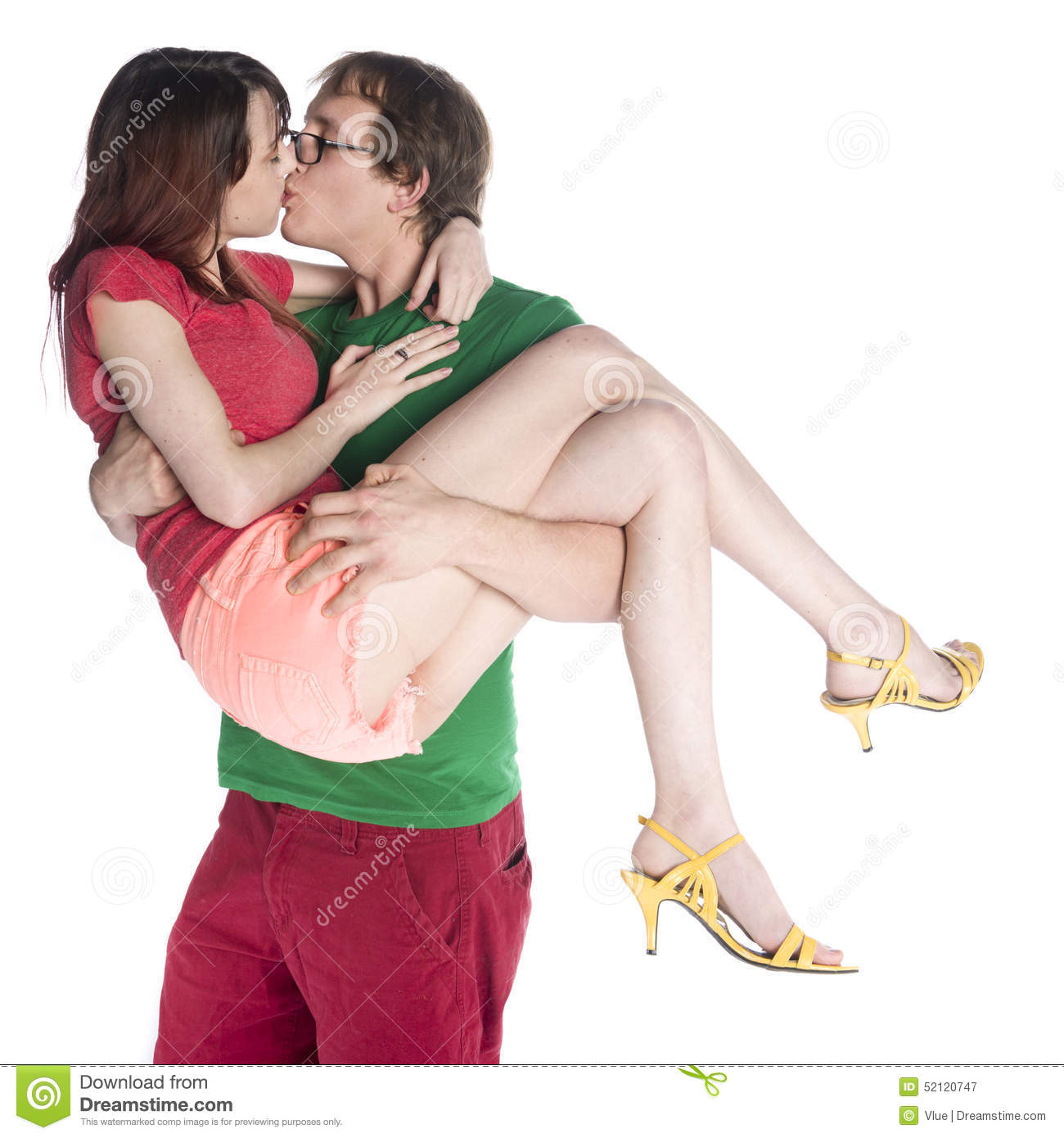 Man Carrying Her Girlfriend While Kissing Stock Photo
